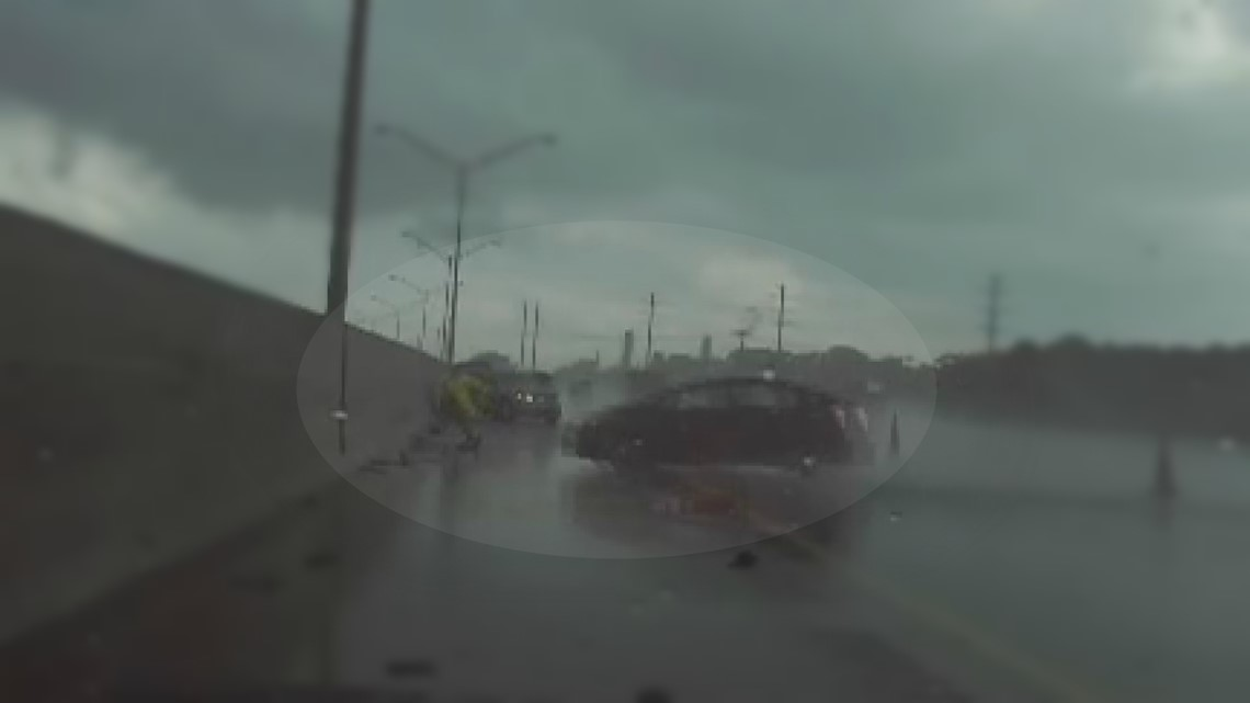 Florida trooper jumps, narrowly misses getting crushed by hydroplaning car