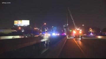 1 dead after crash sends car off bridge