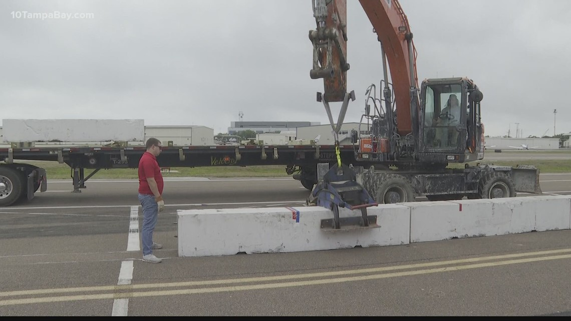 On track! Work crews start to lay out the 1.8-mile course for Firestone Grand Prix in St. Petersburg