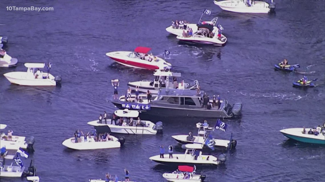 Tampa Bay Lightning parade Stanley Cup down Hillsborough River, packed with fans