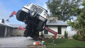 Mobile crane lands on house in construction mishap