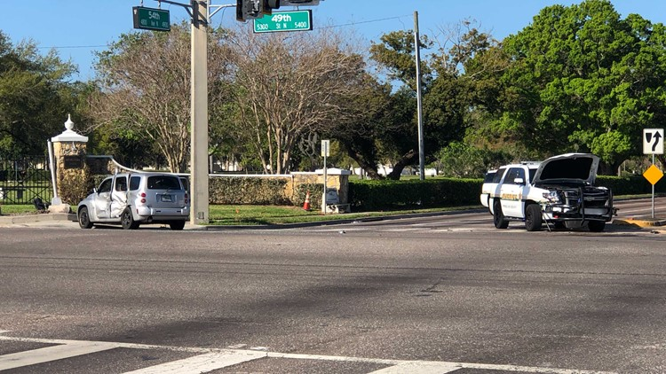 Sheriff's Office cruiser on emergency call hit by car