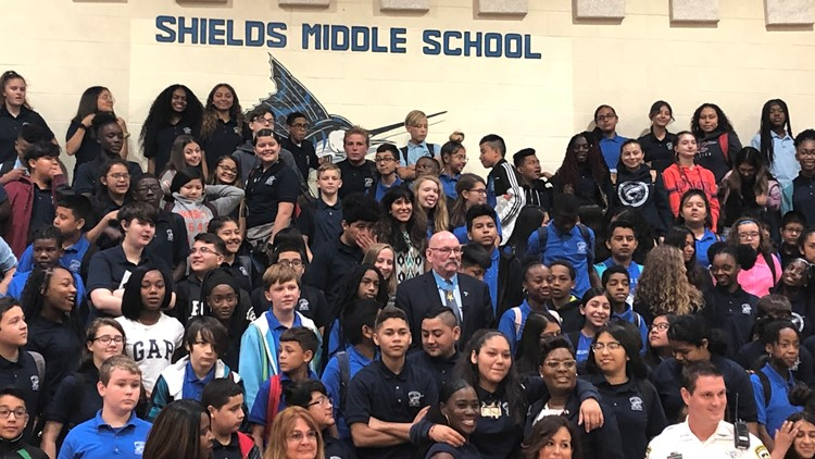 Shields Middle School students pose with Medal of Honor recipient Gary Beikirch