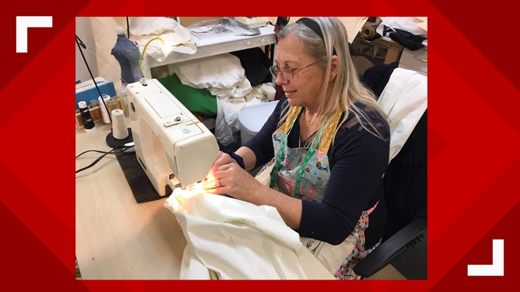 Anna Rosa Dauck sews a pirate costume in the South Tampa Trading Company