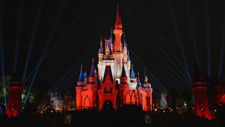 Disney castle illuminated in Bucs colors to celebrate the team's Super Bowl LV win