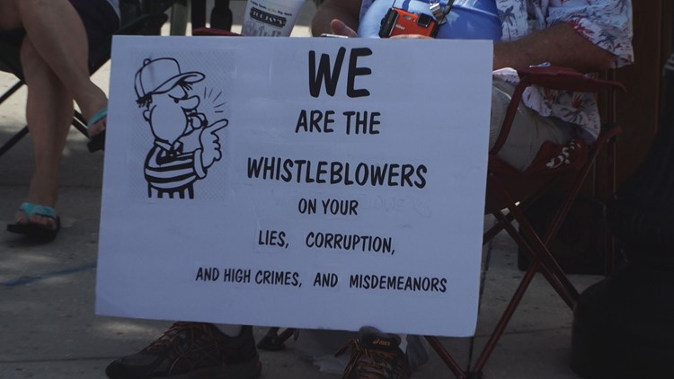 Whistleblower signs appeared during President Trump's visit to Florida