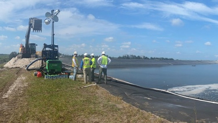 Crews use sand to reinforce steel plate at Piney Point site