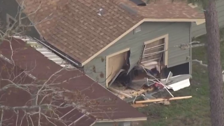 Driver found unconscious after car veers into home