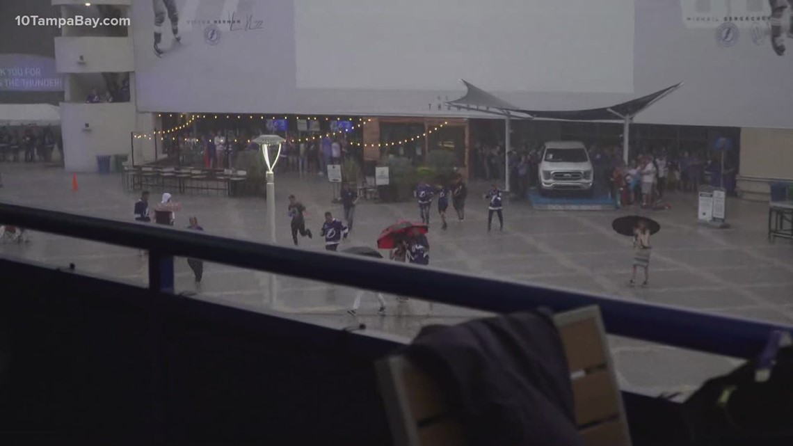 Lightning fans bolt for cover as rain comes down ahead of Game 3