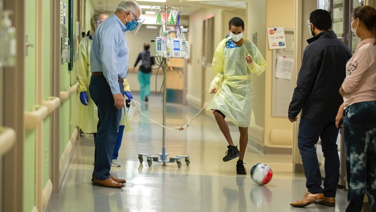 Surgeon and teen share game of soccer after heart transplant