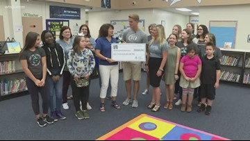 Duke Energy Florida presents check to Sandy Lane Elementary School