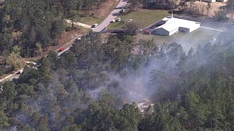 Spring Hill wildfire '100-percent' contained, fire officials say