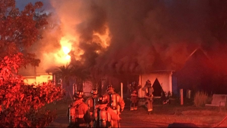 Firefighters battle large house fire in New Port Richey