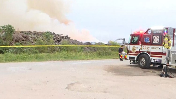 Firefighters working to put out large fire at a Lakeland recycling facility