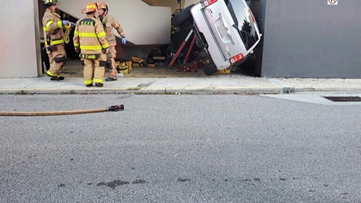 Parking garage crash sends 2 to hospital