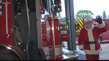 Pinellas Park firefighters team up with Santa to deliver gifts