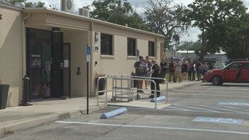 Pet owners line up for food, kitty litter giveaway