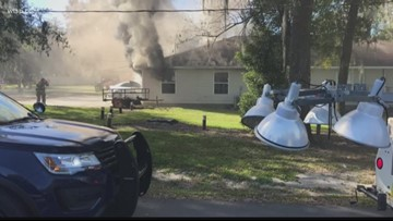 Fire starts after car crashes into building in Dade City