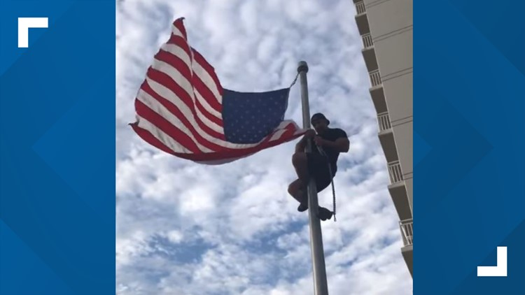 Navy SEAL climbs pole to fix American flag at monument