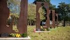 Norfolk women place holiday boughs at war memorial