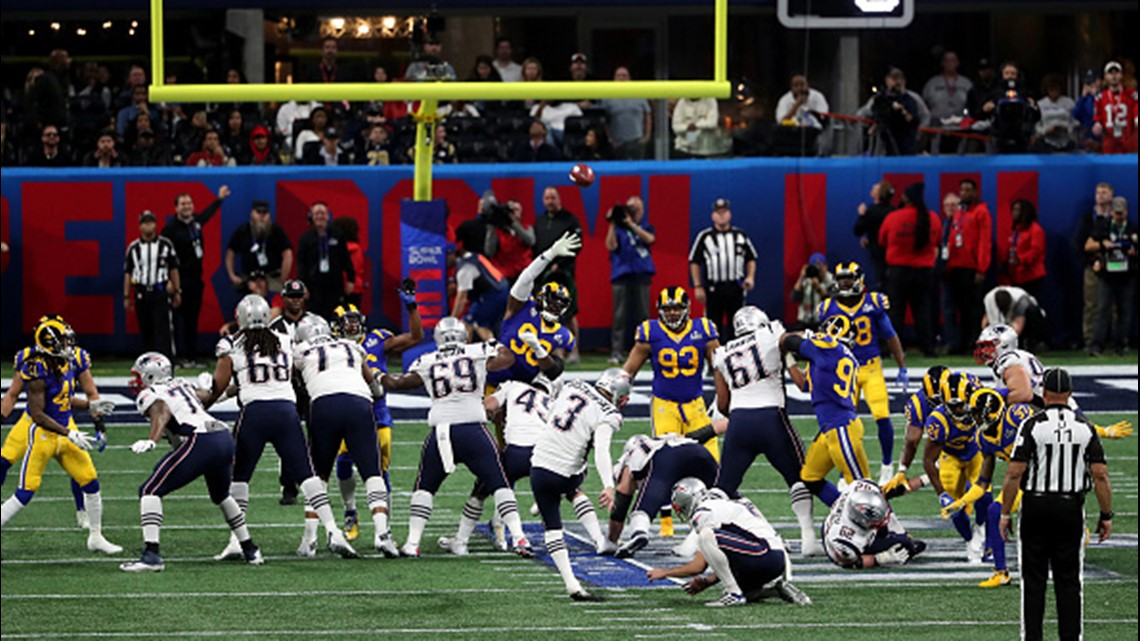 sale retailer b6b6b 0f3f1 Michael Brockers  90 of the Los Angeles Rams attempts to catch the ball in  the second quarter against the New England Patriots during Super Bowl LIII  at ...